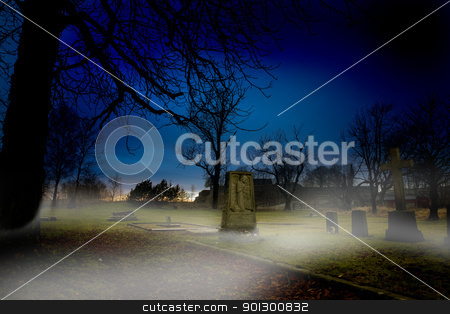 Graveyard stock photo, A spooky graveyard at sundown with mist by Tyler Olson