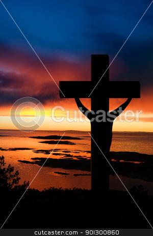 Easter Cross stock photo, A cross at sundown on the ocean by Tyler Olson