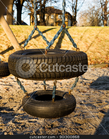 Tire Swing stock photo, A childs swing on a playground by Tyler Olson