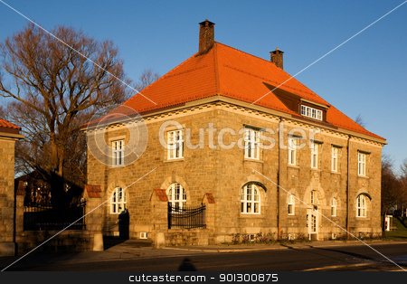 Old Brick Building stock photo, An old brick building in warm sunlight by Tyler Olson