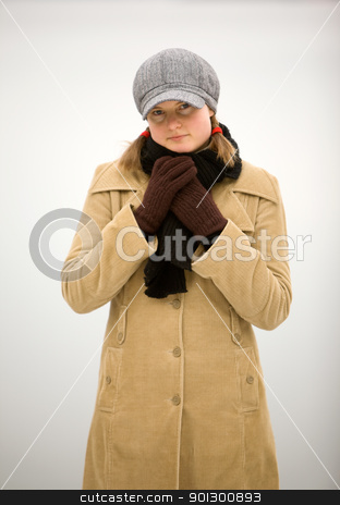 Happy in Winter stock photo, A young woman smiling by the ocean in winter. by Tyler Olson
