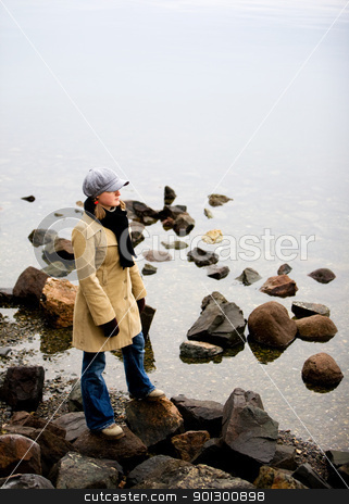 Woman by Ocean stock photo, A woman standing near the ocean by Tyler Olson