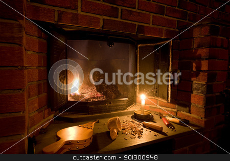 Old Fashioned Fireplace stock photo, A fireplace scene in an old fashioned setting by Tyler Olson