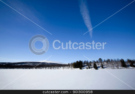 Winter Mountain Landscape stock photo, A mountain in the distance over a frozen lake.in winter. by Tyler Olson