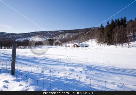Winter Mountain Cabin stock photo, A cabin in the mountains on a winter landscape by Tyler Olson