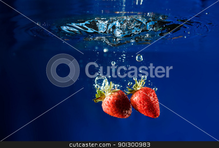 Strawberry Drop in Water stock photo, Two strawberries splashing in water by Tyler Olson