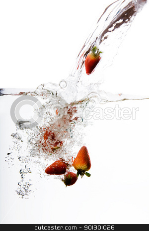 Strawberry Water Splash stock photo, Fresh strawberries being poured in water by Tyler Olson