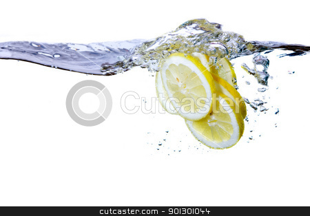 Lemon Slice and Water stock photo, A group of lemon slices dropped in water with bubbles by Tyler Olson