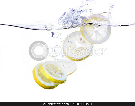 Lemon Slices in Water stock photo, Lemon slices splashing in water - refreshing concept by Tyler Olson