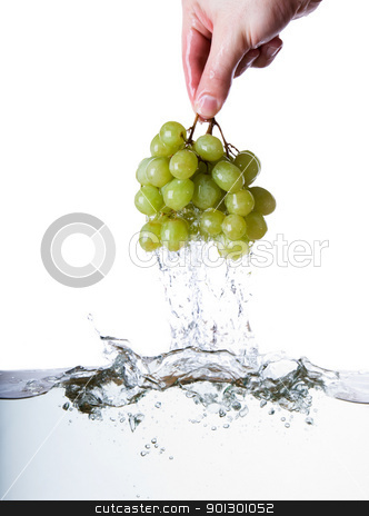 Wet Grapes stock photo, Grapes being pulled out of water by Tyler Olson