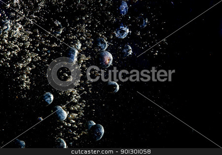 Blueberry Water Background stock photo, Blueberries floating in water with bubbles by Tyler Olson
