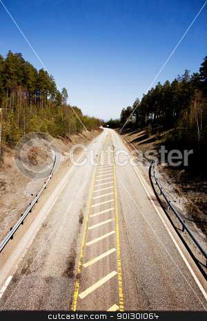 Road into the Distance stock photo, A highway stretching into the distance with a blue sky. by Tyler Olson