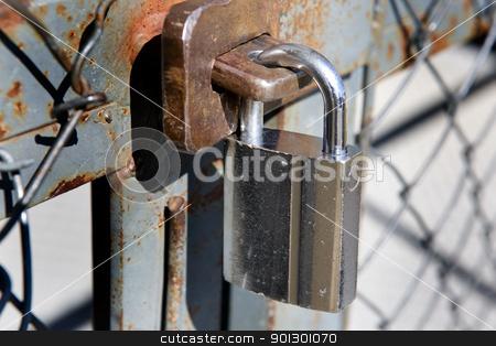 Heavy Lock stock photo, A heavy lock on a wire gate by Tyler Olson