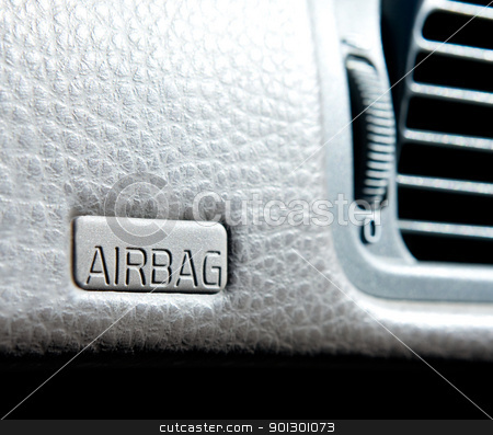 Airbag sign stock photo, An airbag sign in a car on the dash by Tyler Olson