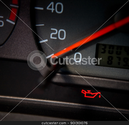 Low Oil stock photo, Low Oil sign in a car that is lit red by Tyler Olson