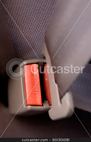 Press Seatbelt Detail stock photo, A seatbelt in a car with cloth seats by Tyler Olson