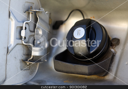 Fuel Cap stock photo, A fuel cap tank on a car open and ready for filling by Tyler Olson