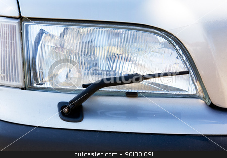 Headligh Detail with Wiper stock photo, A headlight with a wiper detail on a car by Tyler Olson