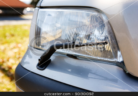 Headlight Detail stock photo, A headlight with a wiper detail on a car by Tyler Olson