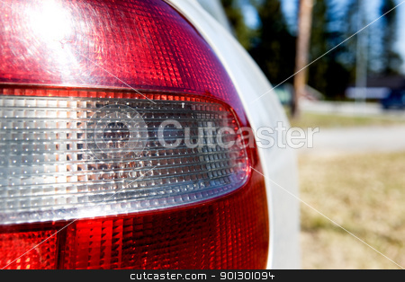 Rear Car Light stock photo, A red and white rear car light with sun reflection by Tyler Olson