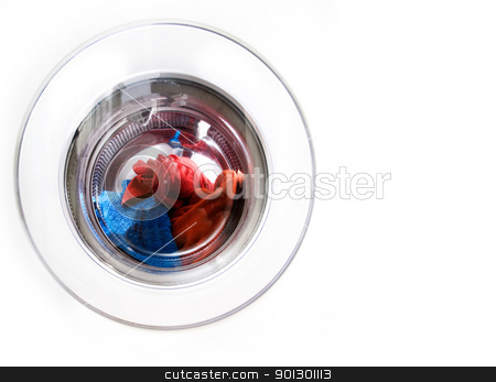 Washing Machine Copy Space stock photo, Washing machine detail with colorful clothes by Tyler Olson