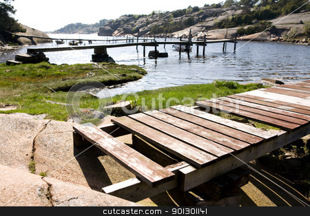 Old Dock stock photo, A number of old docks on an ocean inlet by Tyler Olson
