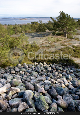 Viking Grave stock photo, View towards the ocean from a viking grave in Norway by Tyler Olson