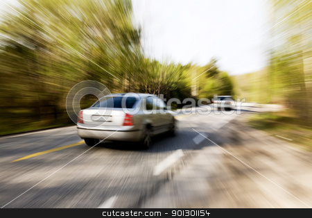 Speeding Car stock photo, A motion blur image of a speeding car by Tyler Olson