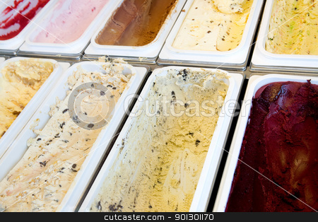 Ice Cream stock photo, Hard ice cream in bulk ready for serving by Tyler Olson