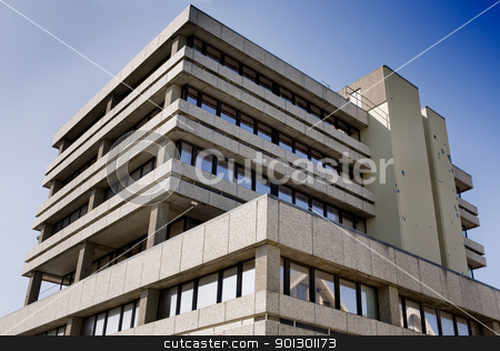 Office Building stock photo, An office building isolated against a sky by Tyler Olson