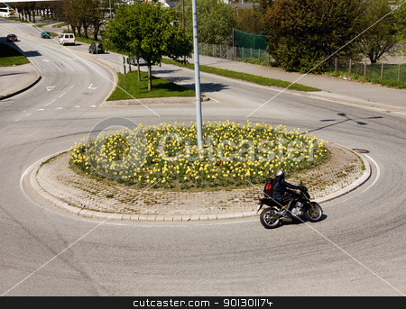 Traffic Circle stock photo, A traffic circle with a motocycle by Tyler Olson