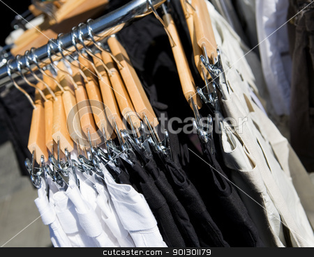 Clothing Rack stock photo, A clothes rack of pants in a store by Tyler Olson