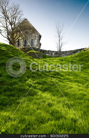 Stone Church stock photo, A stone church on a green meadow by Tyler Olson