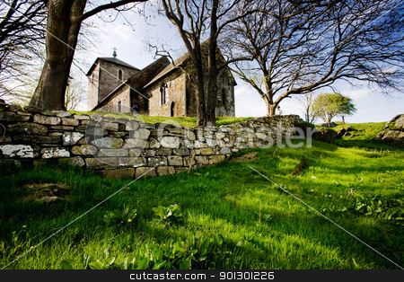Old Stone Church stock photo, A stone church on a green meadow by Tyler Olson