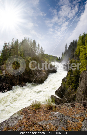 Waterfall in Norwegian Landscape stock photo, A fast flowing river in a picturesque Norwegian landscape by Tyler Olson