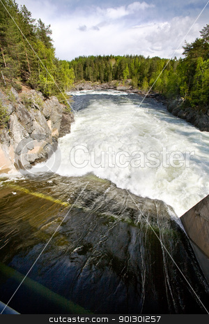 Water Dam stock photo, A hydro electric plant on a river by Tyler Olson
