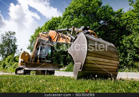 Backhoe stock photo, A backhoe sitting on grass by Tyler Olson