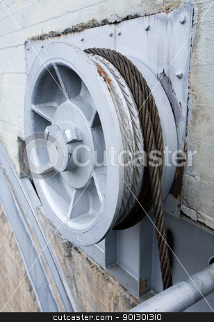Industrial Pulley stock photo, Large industrial pulley system or winch by Tyler Olson