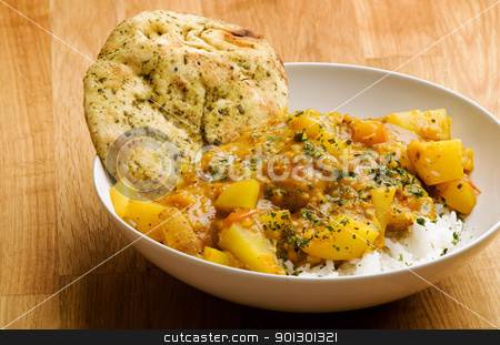 Indian Dish stock photo, An indian vegetarian curry - Dhaal Aloo by Tyler Olson