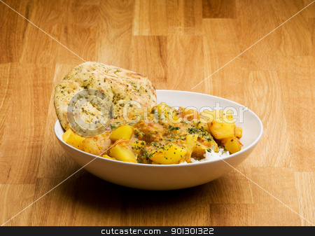 Indian Food stock photo, An Indian meal - Potato curry with Lentis and Naan bread by Tyler Olson