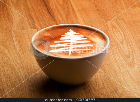 Christmas Gourmet Coffee stock photo, A cappuccino with a christmas tree in latte art by Tyler Olson