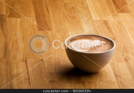 Cafe Latte stock photo, Cafe latte on a wood table with copy space by Tyler Olson