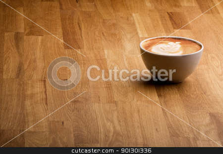 Coffee stock photo, A warm specialty coffe on a wood table by Tyler Olson