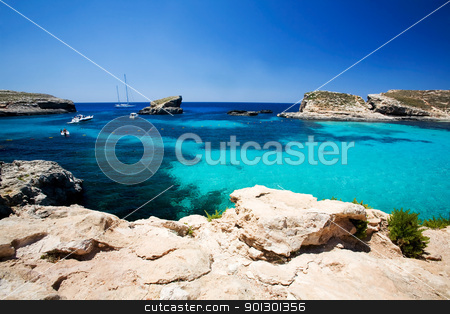 Blue Lagoon stock photo, Blue lagoon swimming cove, Comino island. by Tyler Olson