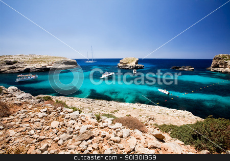 Blue Lagoon stock photo, Blug lagoon on a warm summer day on Comino Island, Malta by Tyler Olson