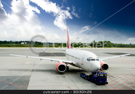 Airplane on Tarmac stock photo, An airplane at the airport on the tarmac by Tyler Olson