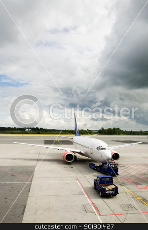 Airplane Airport stock photo, An airplane at the airport on the tarmac by Tyler Olson