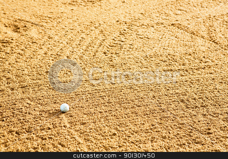 Golf Ball in Bunker stock photo, A golf ball in a sand trap by Tyler Olson