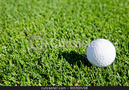 Golf Ball Background stock photo, A golf ball sitting on green grass - background image by Tyler Olson