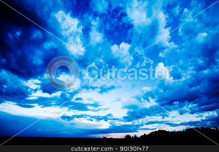 Blue Cloud stock photo, A blue evening sky with clouds on the prairie by Tyler Olson